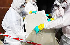 Photo of workers safely disposing of asbestos materials